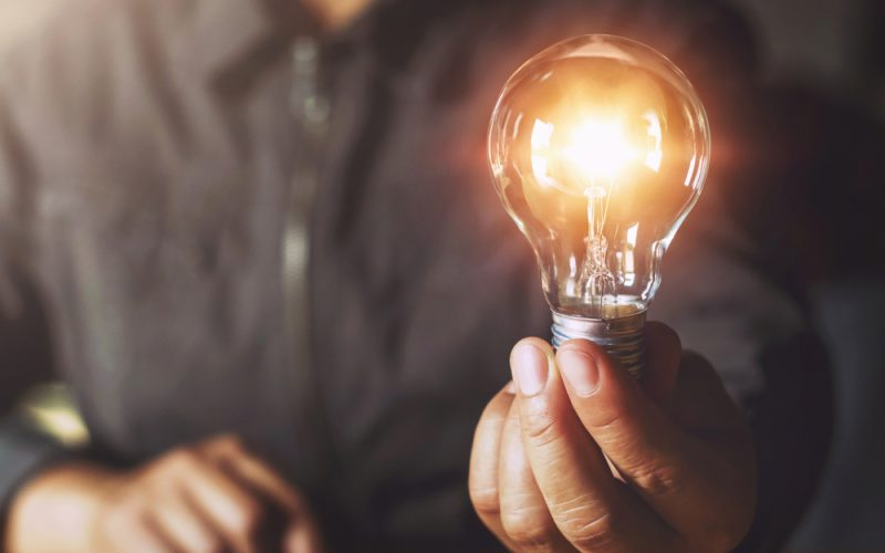 Hand,Holding,Light,Bulb.,Idea,Concept,With,Innovation,And,Inspiration