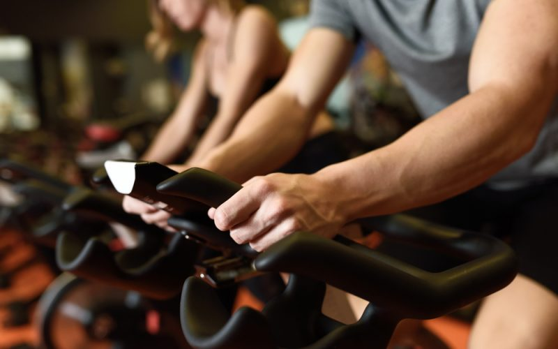 Close-up,Of,Hands,Of,A,Man,Biking,In,The,Gym,