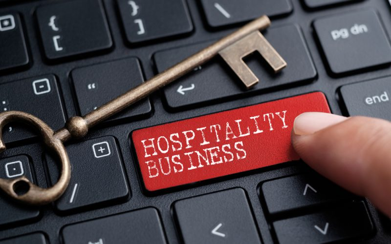 Closed,Up,Finger,On,Keyboard,With,Word,Hospitality,Business